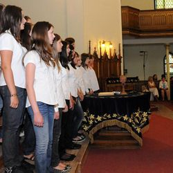 Members of the Franz Schubert Children's Choir (SVK) sing at the IV. Pannonia Cantat Youth Choir Festival Aug. 26, 2010 in Kaposvar, Hungary.