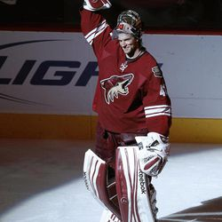 Phoenix Coyotes' Mike Smith waves to the crowd after defeating the Columbus Blue Jackets in an NHL hockey game on Tuesday, April 3, 2012, in Glendale, Ariz. Smith stopped 54 shots and earned his third straight shutout in the 2-0 victory over the Blue Jackets.