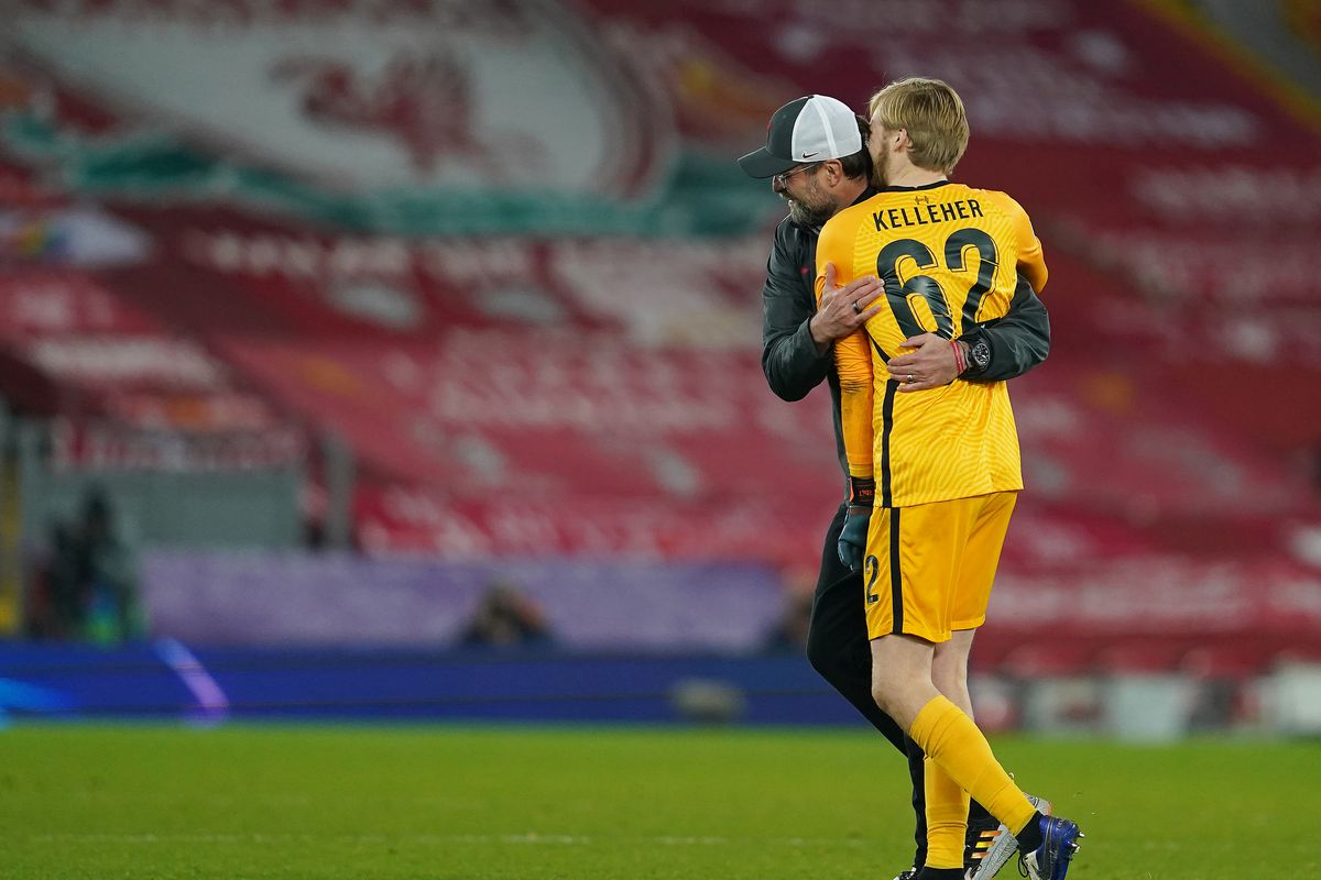 Jurgen Klopp gives Caoimhin Kelleher a hug following the final whistle after the team's victory in the UEFA Champions League Group D stage match between Liverpool FC and Ajax Amsterdam at Anfield on December 01, 2020 in Liverpool,