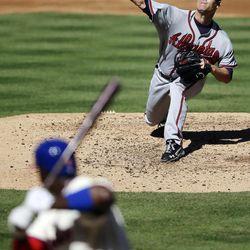 Atlanta Braves' Tim Hudson delivers against Philadelphia Phillies' Ryan Howard in the second inning of a baseball game, Sunday, Sept. 23, 2012, in Philadelphia.