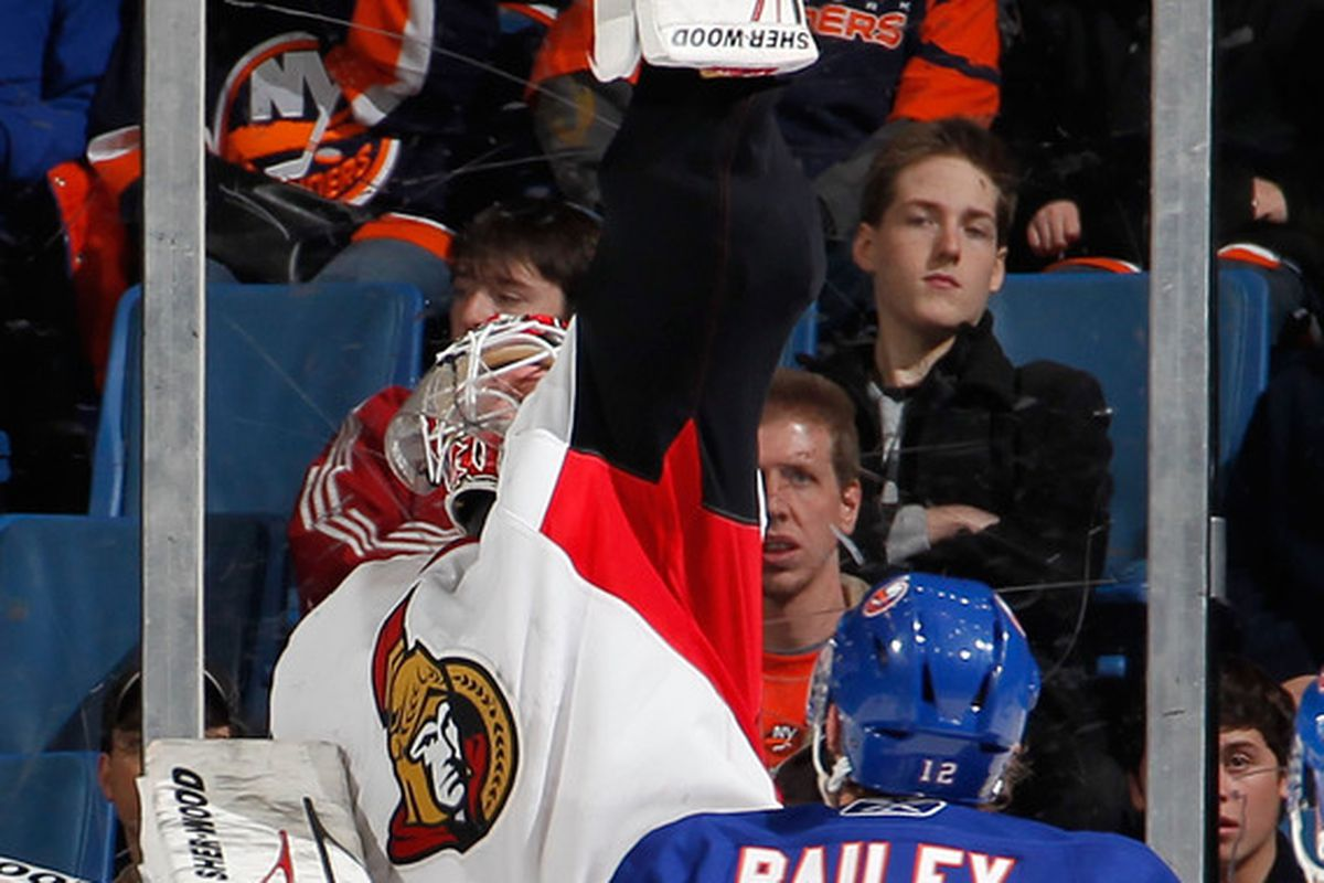 Robin Lehner gloves down a shot that just might have been going a little, teensy bit high of the net. (Photo by Paul Bereswill/Getty Images)