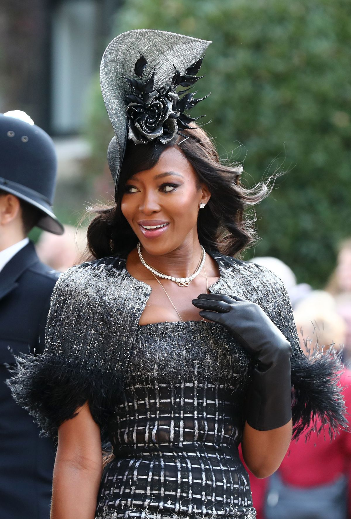 Naomi Campbell smiles to someone at her side.