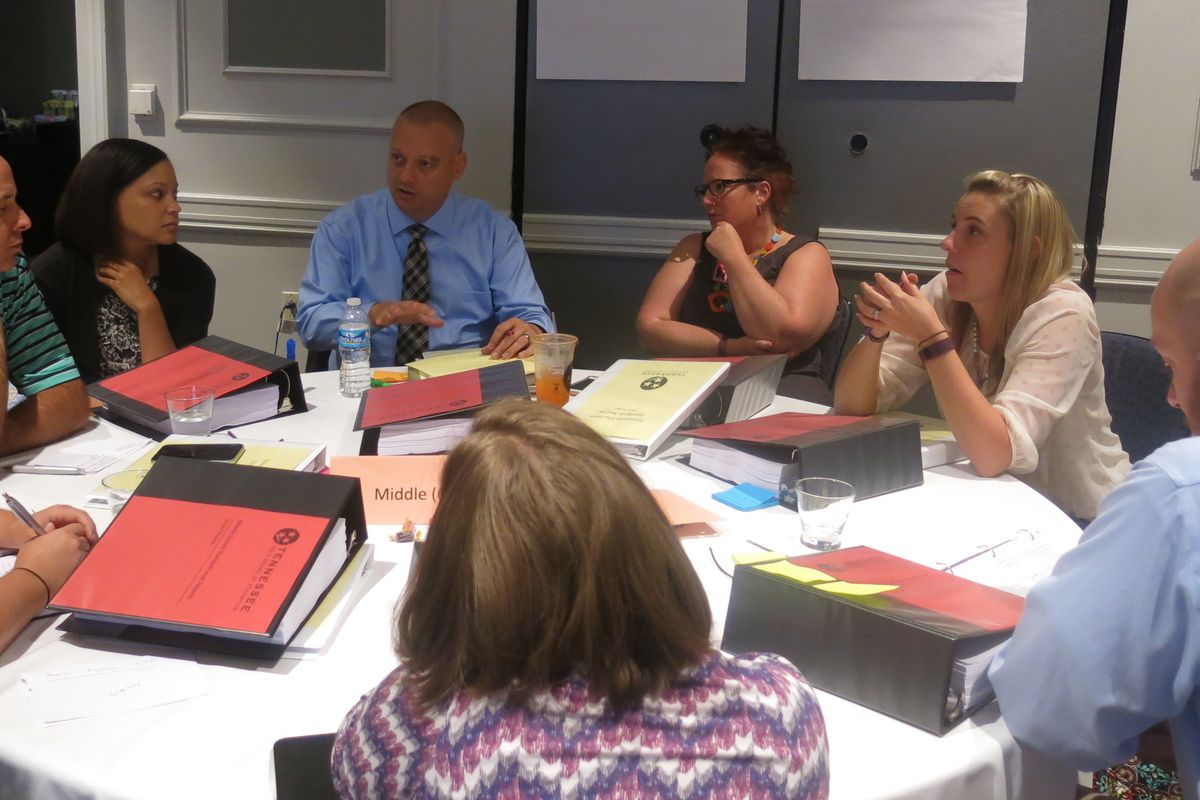 A panel of middle school social studies teachers, chaired by Hamblen County's Scott Ezell (second from left), get to work during meetings this week in Franklin to review and revise Tennessee's social studies standards.