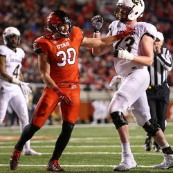 Utah Utes linebacker Cody Barton (30) and Colorado Buffaloes wide receiver K.D. Nixon (13) scuffle during the game at Rice-Eccles Stadium in Salt Lake City on Saturday, Nov. 25, 2017.
