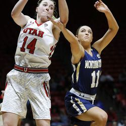 Utah Utes guard Paige Crozon (14) pulls in a rebound with Montana State Bobcats guard Lindsay Stockton (11) at right during NIT women's basketball action in Salt Lake City, Friday, March 18, 2016.
