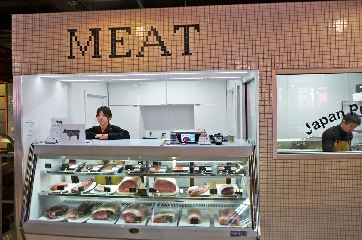 The supermarket boasts a butcher shop.