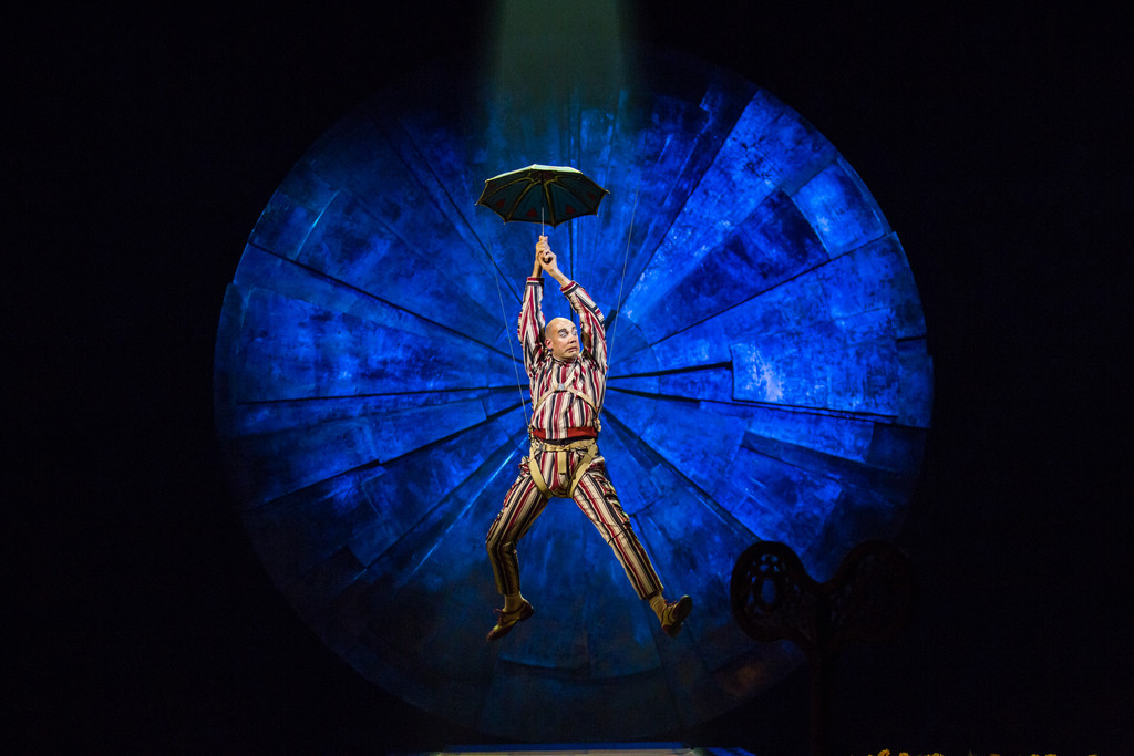 """A clown with an umbrella in Cirque du Soleil's """"Luzia"""" suggests the use of water in the spectacle.   MATT BEARD"""