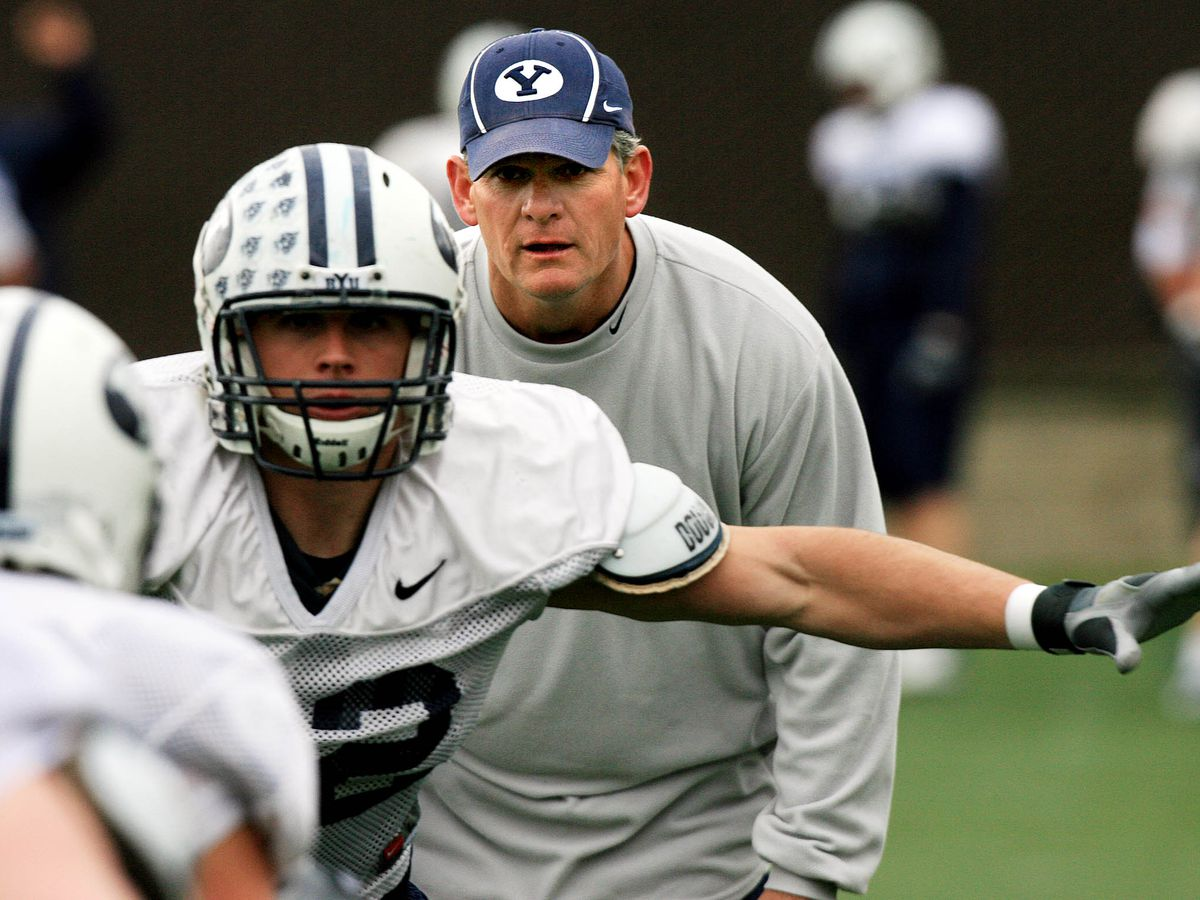 Linebackers coach Paul Tidwell watches during practice as the BYU football team works out in 2007.