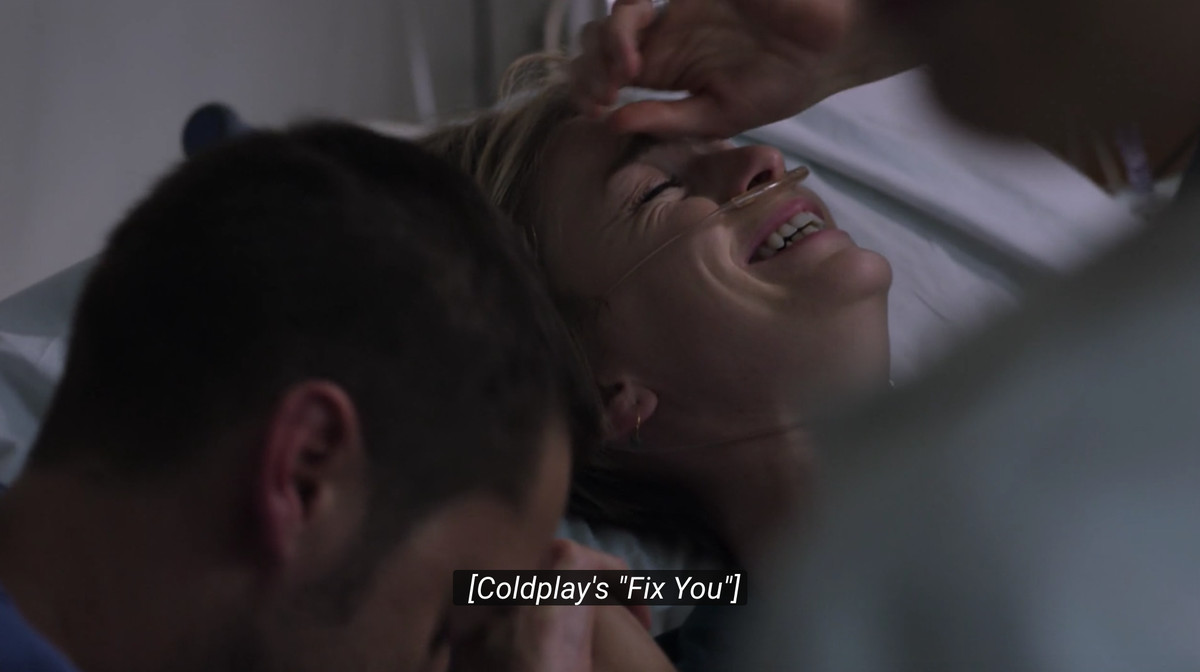 """Still of 'New Amsterdam' with the closed caption of Coldplay's """"Fix You"""""""
