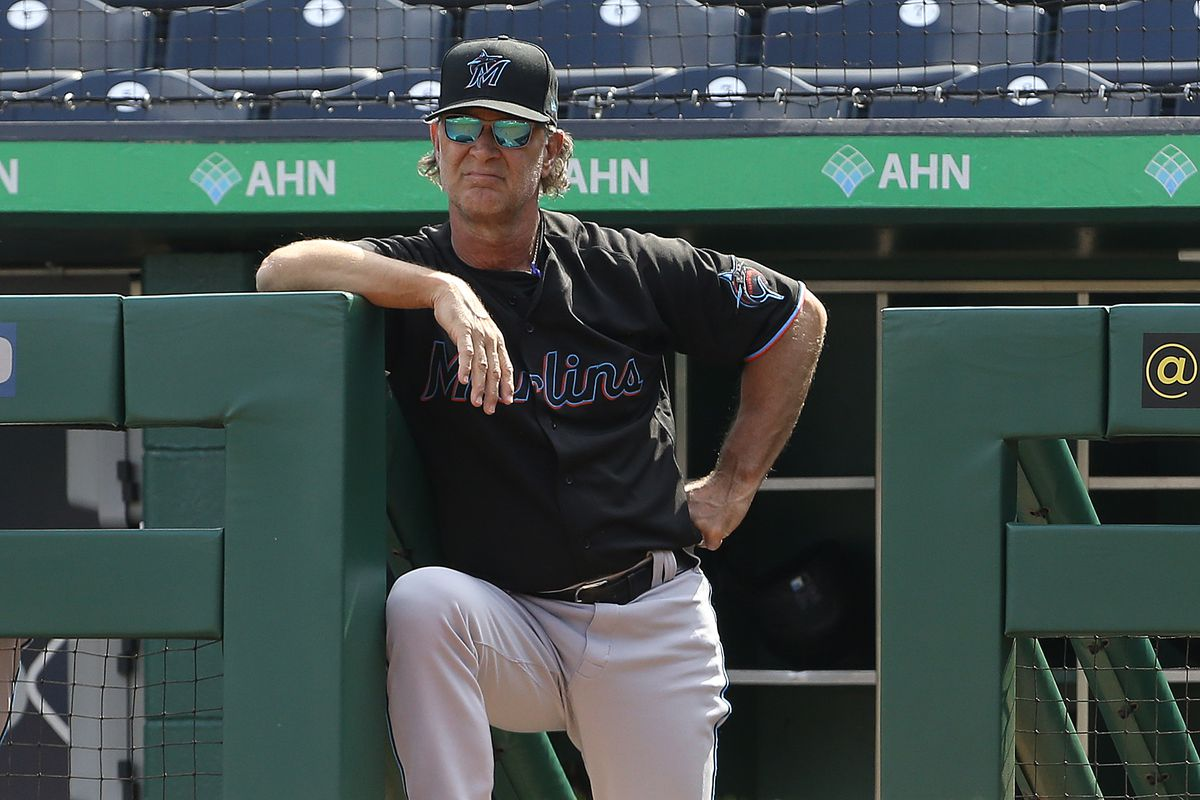 Miami Marlins manager Don Mattingly (8) looks on from the dugout during the first inning against the Pittsburgh Pirates at PNC Park