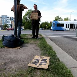 Jessie Cone flies a sign on 400 South in Salt Lake City on Friday, May 1, 2015. A Utah Policy poll finds 2/3 of Salt Lake City residents think panhandling should be illegal. Cone believes that there would be a rise in shoplifting if panhandling becomes fully illegal.