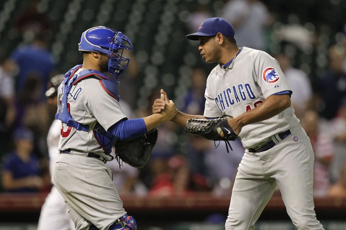 Carlos Marmol of the Chicago Cubs shakes hands with Welington Castillo of the Chicago Cubs after the final out against the Houston Astros at Minute Maid Park in Houston, Texas. (Photo by Bob Levey/Getty Images)