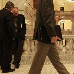 Lobbyist and former legislator Kelly Atkinson, left, talks with Sen. Chris Buttars, R-West Jordan, during the final hours of the 2009 Utah Legislature Thursday.