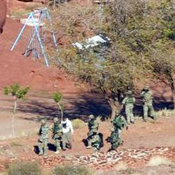 Law enforcement officers converge near Caveman Ranch in Moab, Tuesday Nov. 23, 2010 while searching for Lance Arellano.