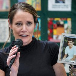 Keri Stephens holds a photo of her son, Anthony Whitaker, who donated organs and tissue after his death, at a ceremony hosted by Intermountain Donor Services in Salt Lake City on Wednesday, Dec. 21, 2016.
