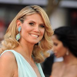 """FILE - This Sept. 23, 2012 file photo shows model and host of """"Project Runway,"""" Heidi Klum arriving at the 64th Primetime Emmy Awards at the Nokia Theatre in Los Angeles. Sunday's Emmy Awards opened the first big fashion red-carpet of the season _ and it was a long runway: a parade of rainbow-bright gowns, skyscraper heels, glittering clutches that only hold a lipstick, along with millions of dollars in jewels."""