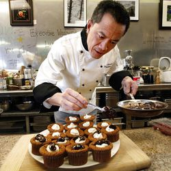 Hai Fitzgerald prepares flourless chocolate cakes at his restaurant, Thyme & Seasons Market Place.