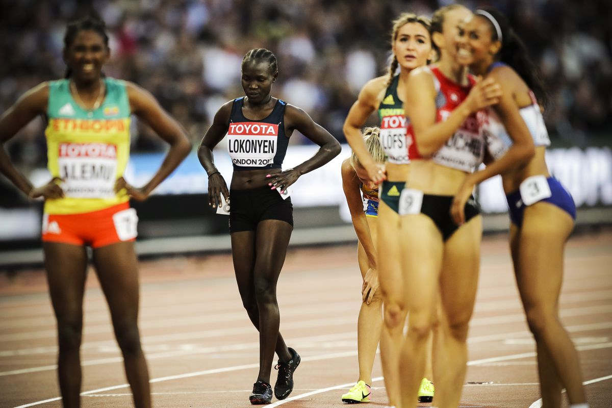 Refugee team's Rose Lokonyen crosses the finish line in a Women's 800m heat during the World Athletics Championships in London, on August 10, 2017.