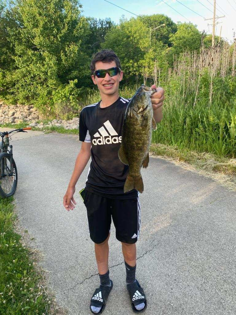 Isaac Biggerstaff with a fine Des Plaines River smallmouth bass. Provided photo