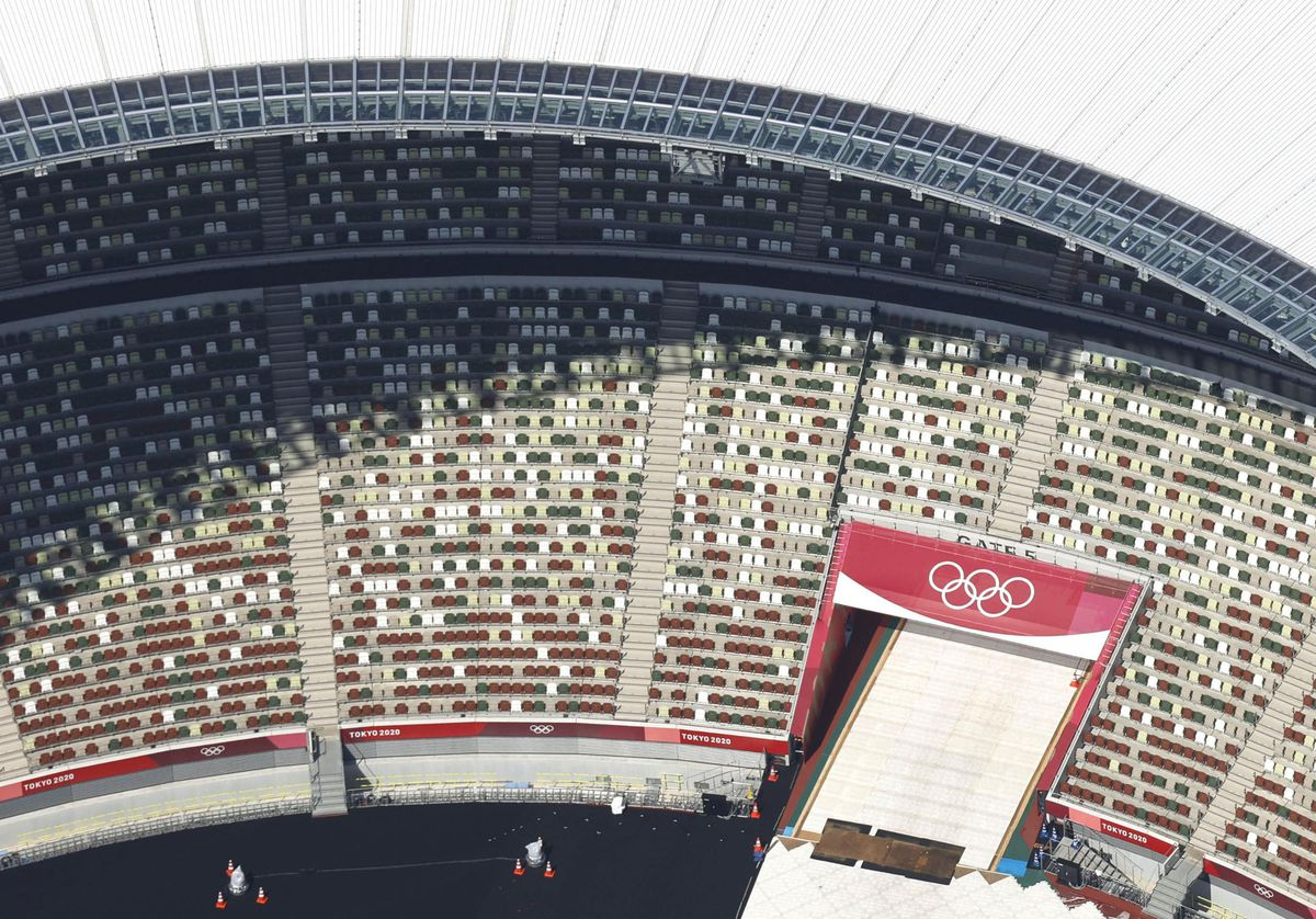 In this aerial photo, the Olympic rings are seen with spectators' seats at the National Stadium in Tokyo.