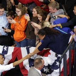 President Barack Obama reaches over to greet supporters after speaking at a campaign event at Bowling Green State University, Wednesday, Sept. 26, 2012, in Bowling Green, Ohio.