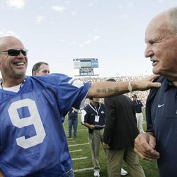 Former BYU QB Jim McMahon laughs with former coach Lavell Edwards during a halftime show in Provo, Utah on Saturday, Sept. 4, 2010.