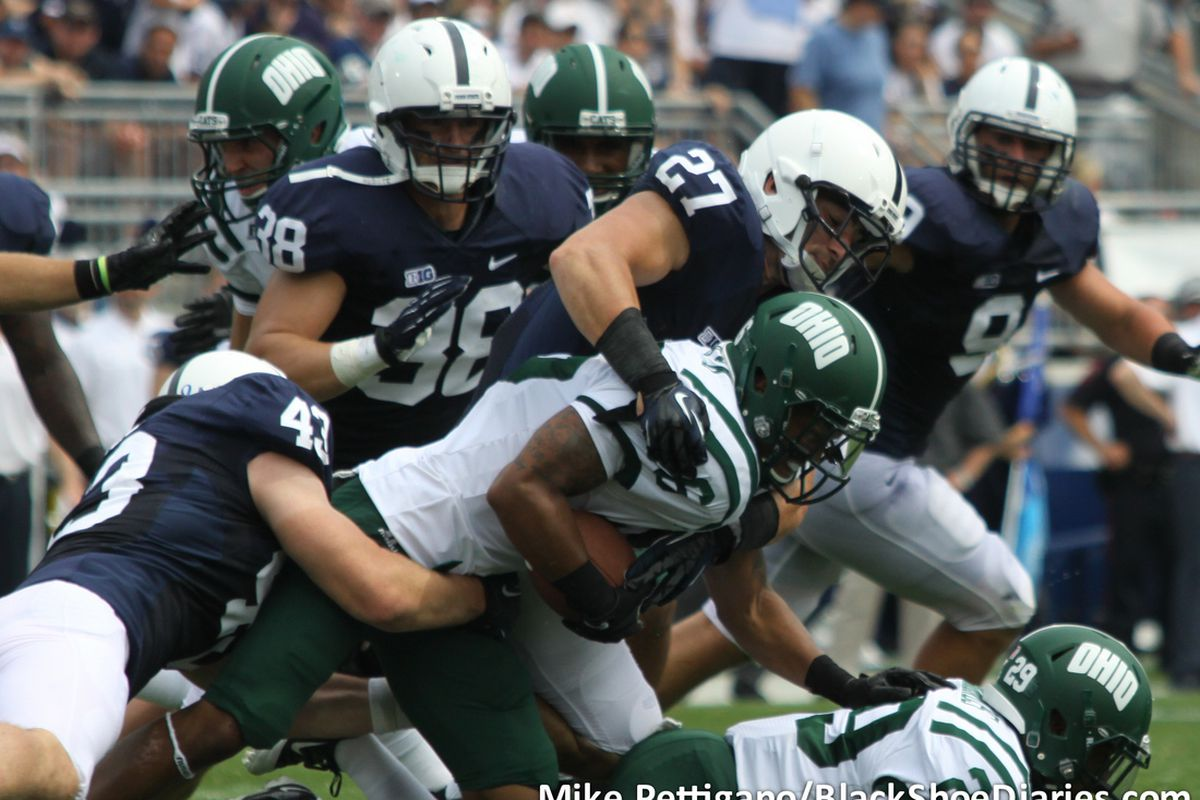 Sept. 1, 2012; Jake Fagnano (27) and Mike Hull (43) tackle the Ohio ball carrier. Penn State fell to the Ohio Bobcats, 24-14. (Photo by Mike Pettigano)