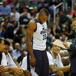 Mike Harris is introduced by David Locke before the Utah Jazz scrimmage in Salt Lake City, Saturday, Oct. 5, 2013.
