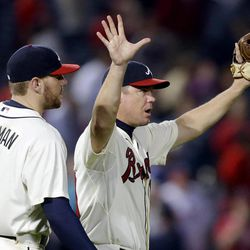 Atlanta Braves' Chipper Jones, right, celebrates with teammate Freddie Freeman after the Braves defeated the Washington Nationals 5-1 in a baseball game Sunday, Sept. 16, 2012, in Atlanta.