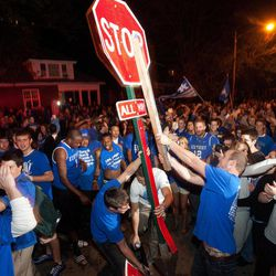 Kentucky fans uproot a traffic sign on the corner of Elizabeth and State Streets as they celebrate Kentucky's 69-61 win over Louisville in an NCAA Final Four semifinal college basketball tournament game, Saturday, March 31, 2012, in Lexington, Ky.