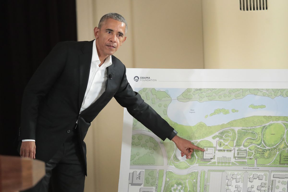 Former President Barack Obama points out features of the proposed Obama Presidential Center, which is scheduled to be built in nearby Jackson Park, during a gathering at the South Shore Cultural Center on May 3, 2017 in Chicago, Illinois. The Presidential Center design envisions three buildings, a museum, library and forum. Obama was accompanied at the event by his wife Michelle who was making her first trip back to Chicago since leaving the White House in January.