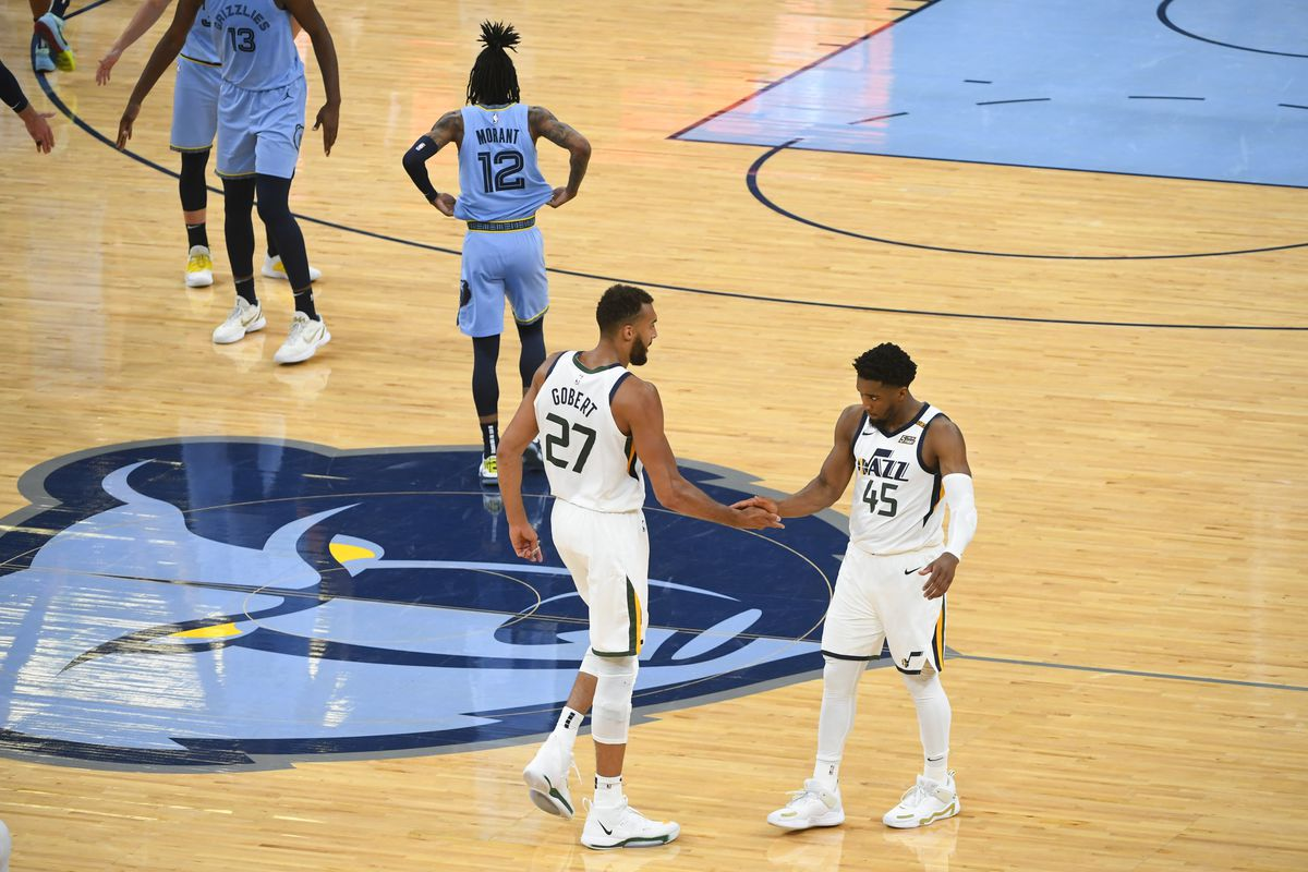 Utah Jazz center Rudy Gobert and guard Donovan Mitchell congratulate each other at the end of their Game 3 win over the Memphis Grizzlies.