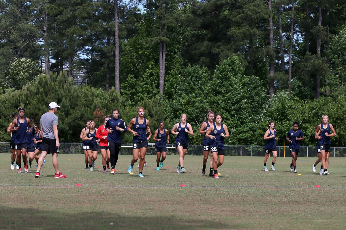 North Carolina Courage players warm up at the start of practice, at WakeMed Soccer Park Field 6 in Cary, NC.