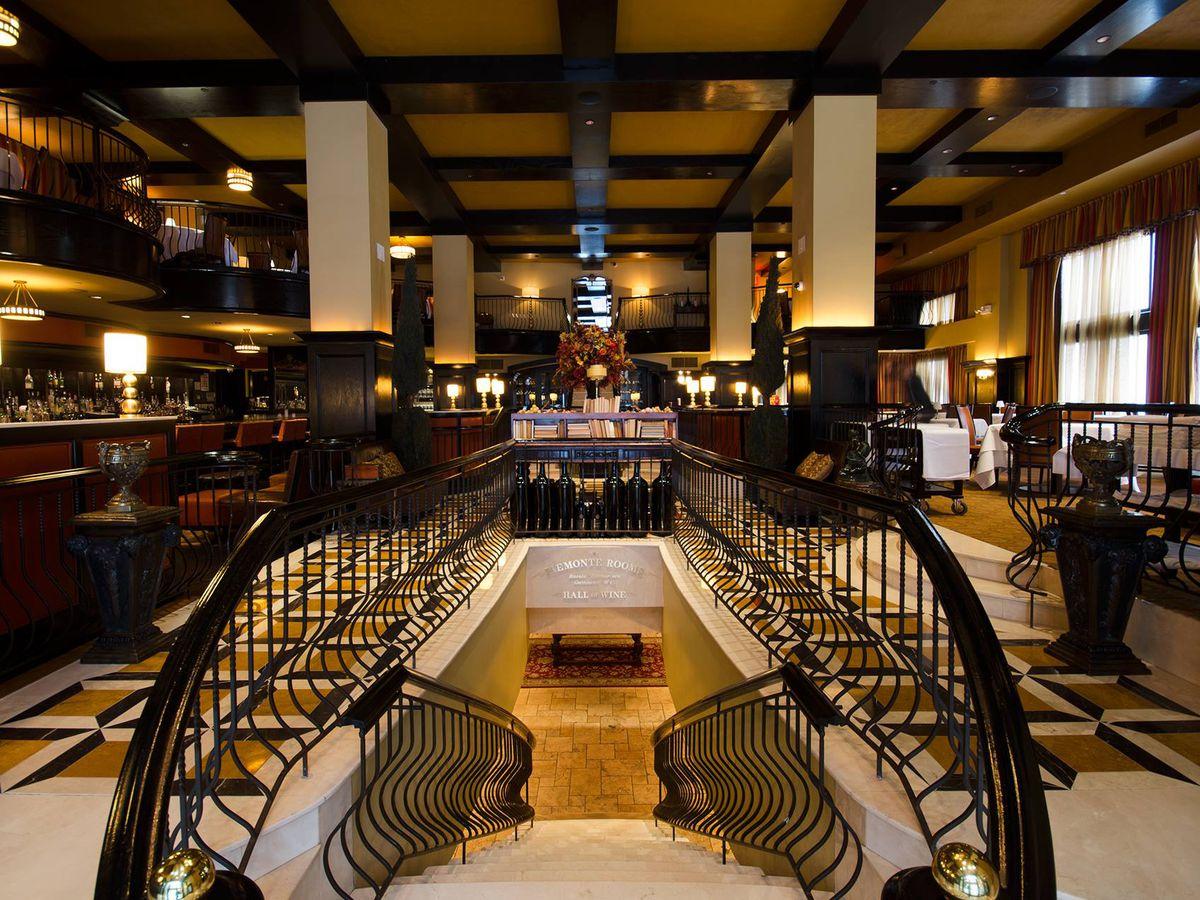Large black and beige interior of a bi-level restaurant