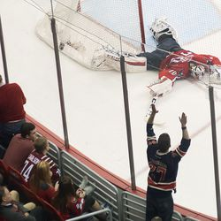 Holtby Lays on Ice After Goal