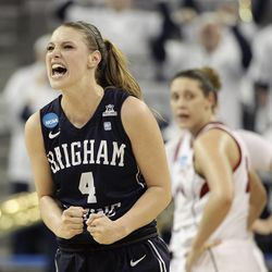 BYU's Kim Beeston celebrates a basket made by her teammate against Nebraska during the second half of a second-round game in the NCAA women's college basketball tournament on Monday, March 24, 2014, in Los Angeles. BYU won 80-76. (AP Photo/Jae C. Hong)