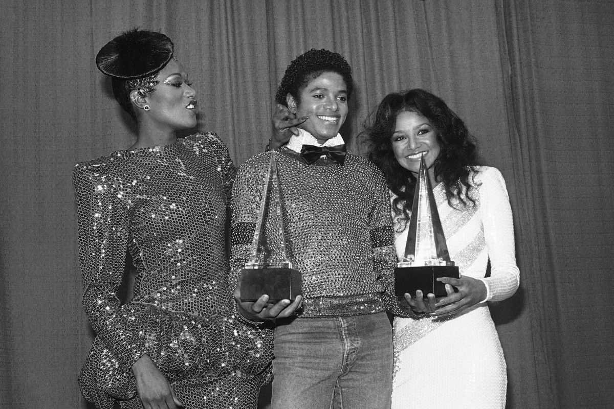"""Bonnie Pointer (left) and LaToya Jackson join Michael Jackson in celebrating the two American Music Awards he won for """"Off the Wall"""" in 1981.   AP files"""
