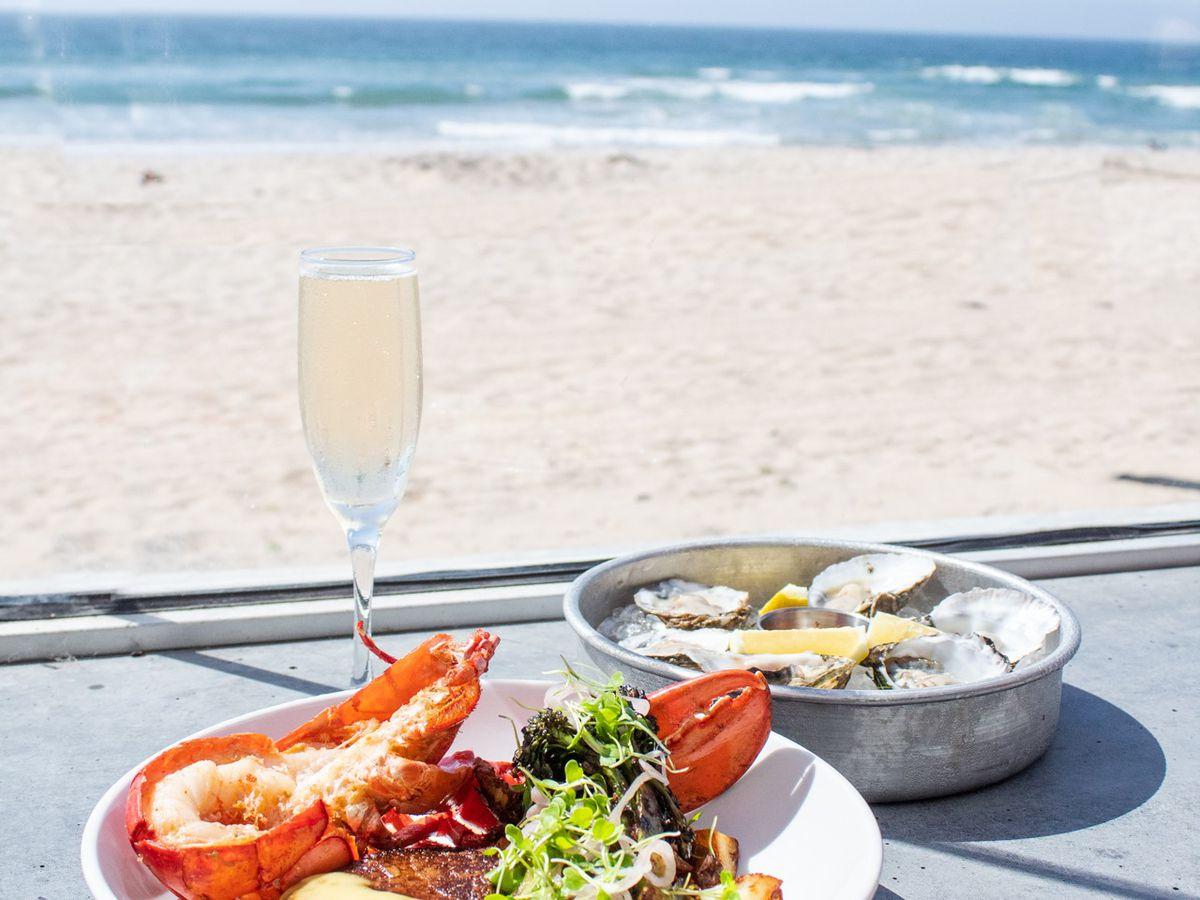 Lobster and steak overlooking ocean