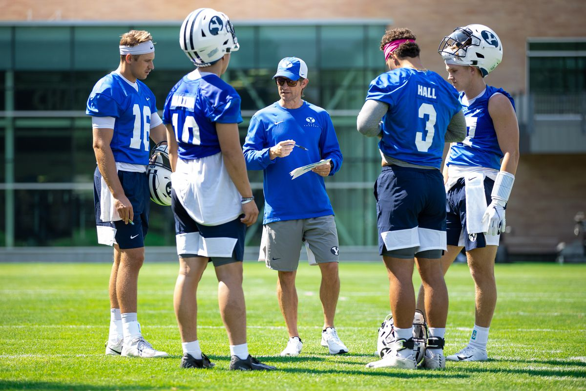BYU offensive coordinator Aaron Roderick gathers with his QBs during fall camp in Provo.