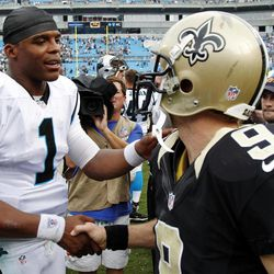 Carolina Panthers quarterback Cam Newton (1) greets New Orleans Saints quarterback Drew Brees (9) after an NFL football game in Charlotte, N.C., Sunday, Sept. 16, 2012. The Panthers won 35-27.