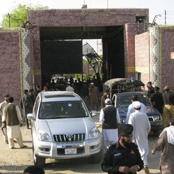 """Pakistani security officials visit the central jail in Bannu, 170 kilometer (106 miles) south of Peshawar, Pakistan on Sunday, April 15, 2012. Taliban militants battled their way into the prison on Sunday, freeing close to 400 prisoners, including at least 20 described by police as """"very dangerous"""" insurgents, authorities and the militants said."""