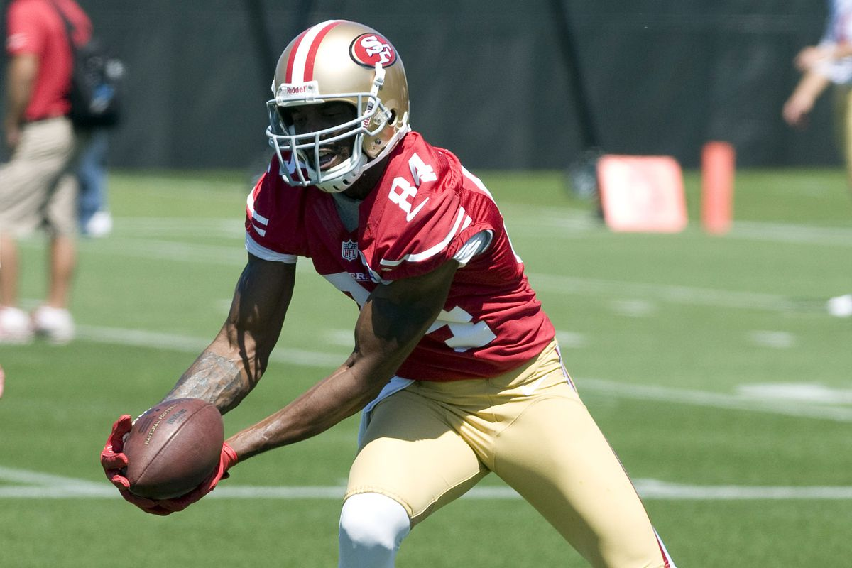 July 27, 2012; Santa Clara, CA, USA; San Francisco 49ers wide receiver Randy Moss (84) catches a pass during training camp at the 49ers practice facility.  Mandatory Credit: Ed Szczepanski-US PRESSWIRE