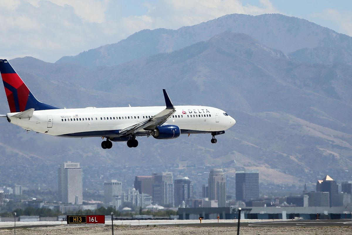 A Delta plane lands at the Salt Lake City International Airport on Tuesday, Sept. 13, 2016.