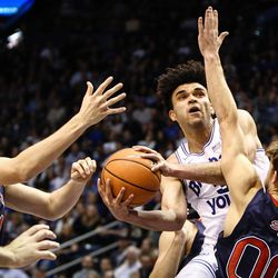 Brigham Young Cougars guard Elijah Bryant (3) drives and shoots around Saint Mary's Tanner Krebs (00) in the first half as the BYU Cougars take on the Saint Mary's Gaels in the Marriott Center in Provo on Saturday, Dec. 30, 2017.