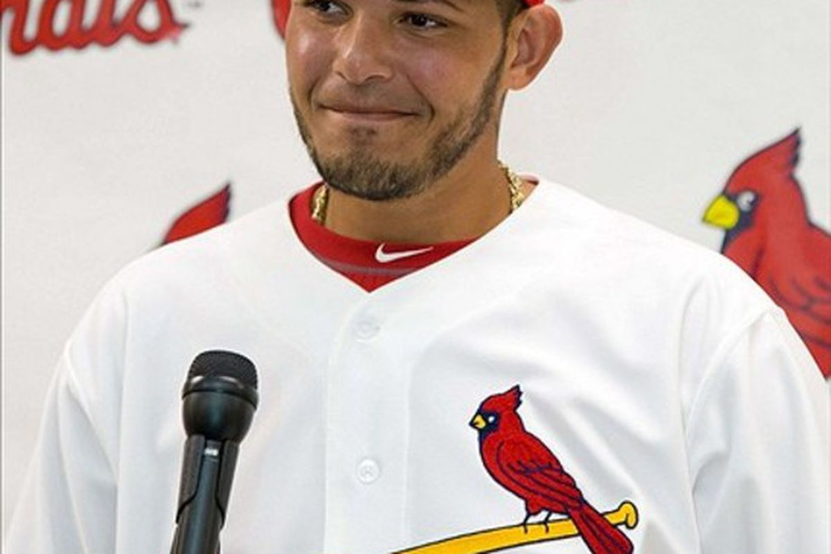 Mar 1, 2012; Jupiter, FL. USA; St. Louis Cardinals catcher Yadier Molina (4) addresses the media during a press conference announcing his contract extension with the Cardinals at Roger Dean Stadium. Mandatory Credit: Scott Rovak-US PRESSWIRE