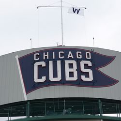 The W flag still flying atop the scoreboard