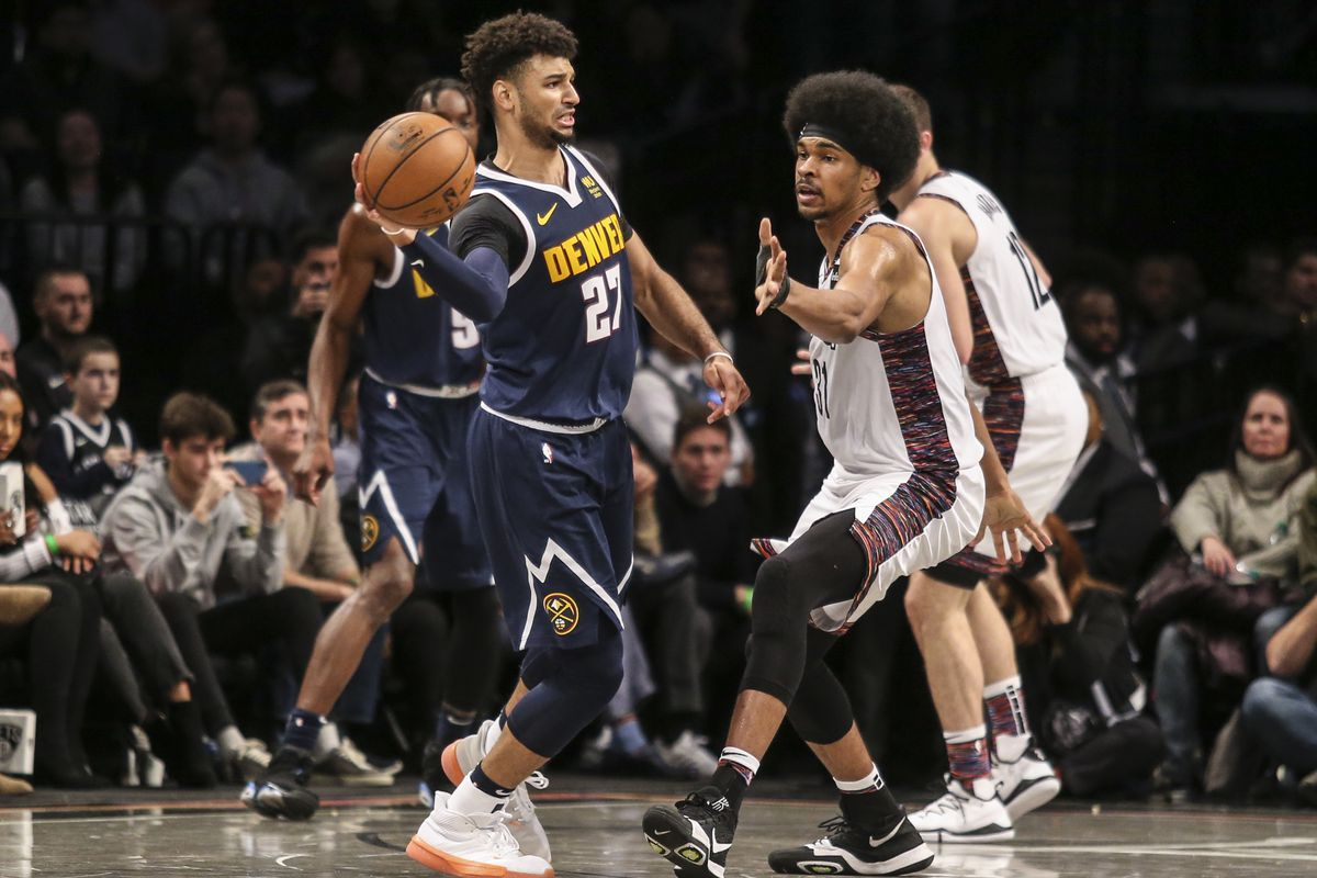 Denver Nuggets guard Jamal Murray looks to make a pass as he is guarded by Brooklyn Nets center Jarrett Allen in the fourth quarter at Barclays Center.