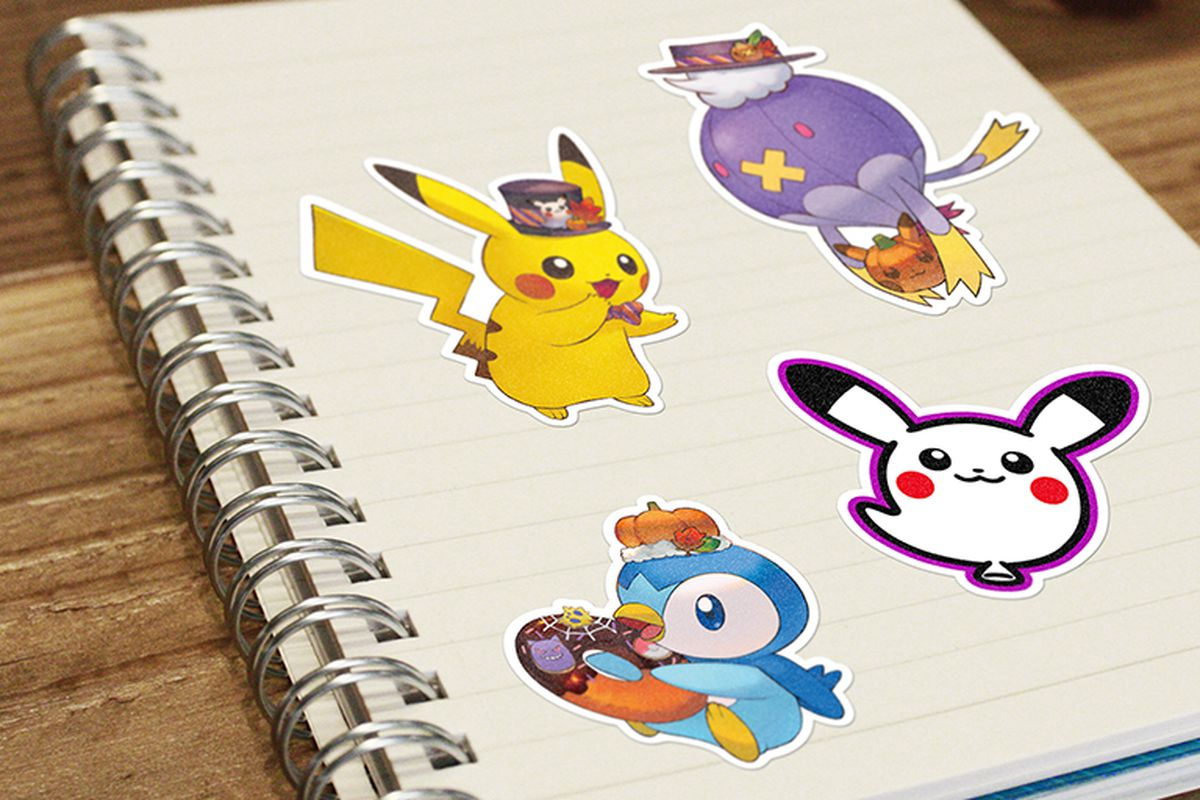 A notebook with several Halloween-themed Pokémon stickers in it