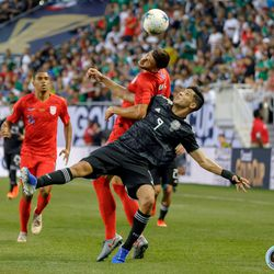 July 7, 2019 - Chicago, Illinois, United States - USA defender Matt Miazga (19) and Mexico forward Raul Jimenez (9) battle for the ball during the Gold Cup Final at Soldier Field.