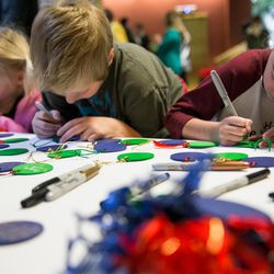 Myleigh, 4, Braxton, 9, and Makenzie Madsen, 11, left to right, decorate ornaments to be hung on a Christmas tree at a ceremony hosted by Intermountain Donor Services in Salt Lake City on Wednesday, Dec. 21, 2016. Makenzie received a heart transplant when she was less than 2 years old.